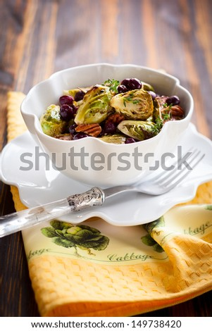roasted brussels sprouts with grapes,nuts and balsamic vinegar - stock photo