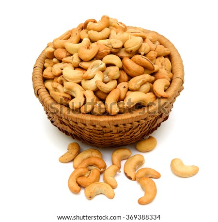 Roasted cashew nuts in basket isolated on white background - stock photo