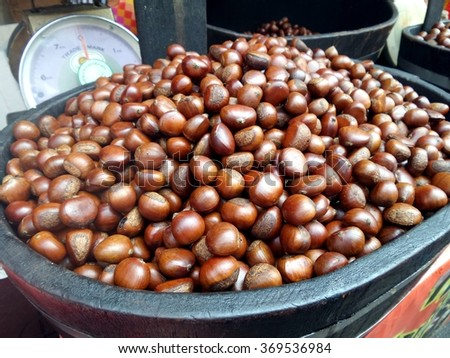 Roasted chestnut for sell in the market, Thailand.