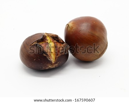 Roasted chestnut with natural one on white background - isolated