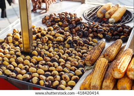 Roasted Chestnuts and corn for sale in a market stall, Istanbul, Turkey - stock photo