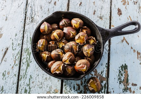 roasted chestnuts in the pan - stock photo