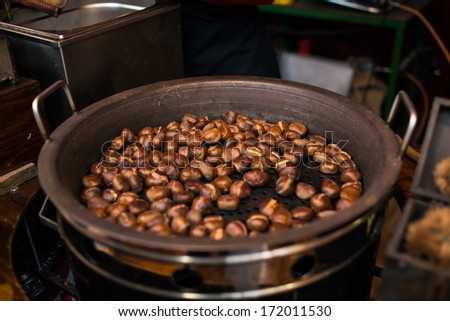 Roasted chestnuts on a Christmas market in Berlin, Germany - stock photo