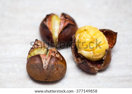 Roasted chestnuts on a table - stock photo