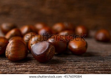 roasted chestnuts on wood background