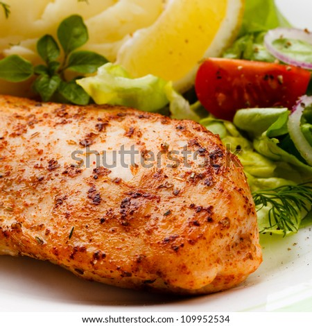 Roasted chicken breast and mashed potatoes - stock photo