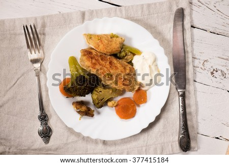 Roasted chicken breast ,grilled broccoli, carrot with tartar sauce - stock photo