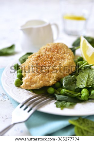 Roasted chicken breast in sesame crust on a white background/ - stock photo
