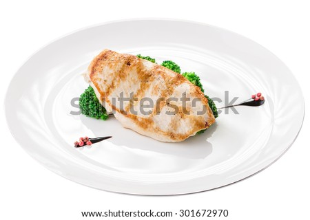 Roasted chicken breast with broccoli isolated on white background. Clipping path - stock photo