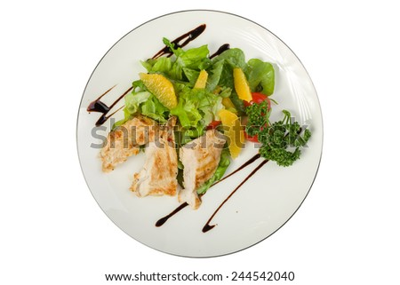 Roasted chicken breast with orange isolated on white background. Clipping path - stock photo