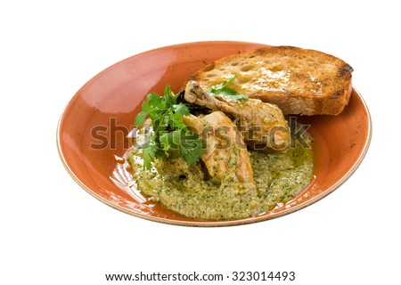 Roasted chicken breast with pesto sauce and toast isolated on white background. Clipping path