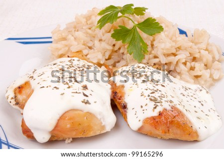 Roasted chicken breast with sour cream served with brown rice