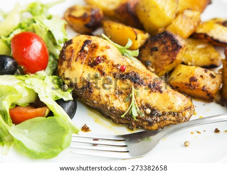 Roasted Chicken Breast with Sweet Potatoes Garnish and Vegetables Salad - stock photo
