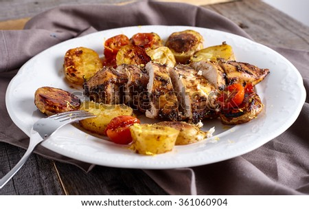 Roasted chicken breast with vegetables - stock photo