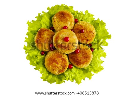 Roasted chicken cutlets on green lettuce. Isolated on white background. Top view. - stock photo