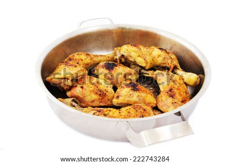 Roasted Chicken Drumsticks on a Baking Pan. Isolated on White Background. - stock photo