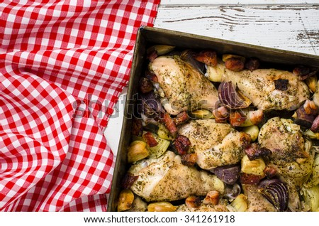 Roasted chicken drumsticks with bacon, onion and garlic - stock photo