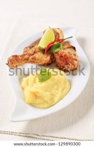 Roasted chicken leg with mashed potatoes - stock photo