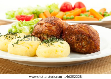 Roasted chicken legs with mashed potatoes and steamed vegetables served with salad vinaigrette clearing