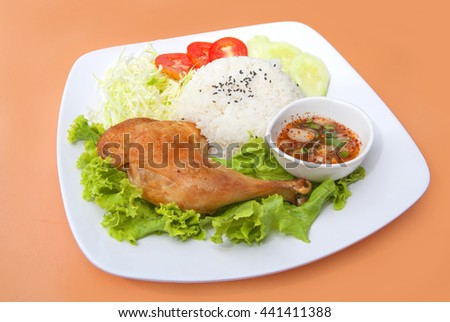 Roasted chicken legs with rice - stock photo