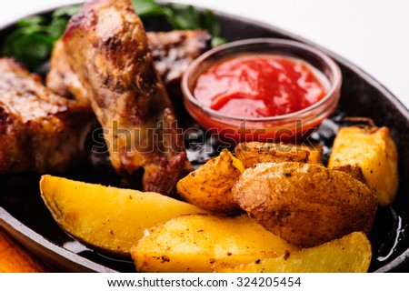 roasted chicken legs with vegetables and potato - stock photo