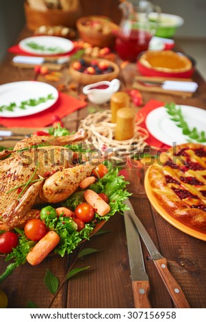 Roasted chicken served for family dinner - stock photo