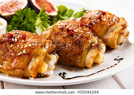 Roasted chicken thighs and vegetables  - stock photo