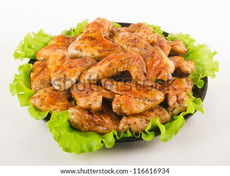 Roasted chicken wings on a plate - stock photo