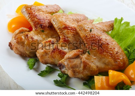 Roasted Chicken wings served salad leaves and parsley