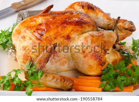Roasted chicken with fresh herbs. Selective focus