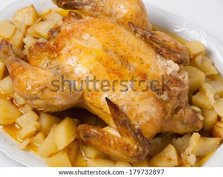 Roasted Chicken with potatos isolated on white background