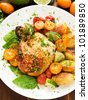 Roasted chicken with stir-fry vegetables, fruits and herbs. Shallow dof. - stock photo