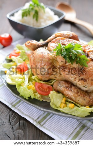 Roasted chicken with vegetable garnish