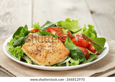 Roasted chicken with vegetable salad and herbs - stock photo