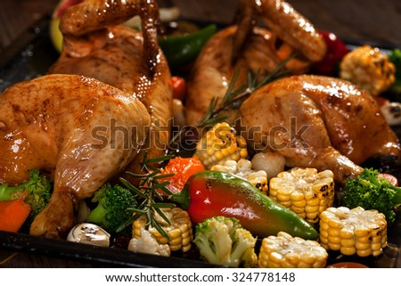 Roasted chicken with vegetables in the oven
