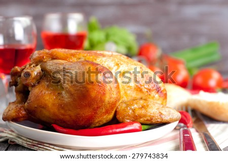 roasted chicken with vegetables - tomato and  salad, Served split roasted stuffed small turkey and vegetables