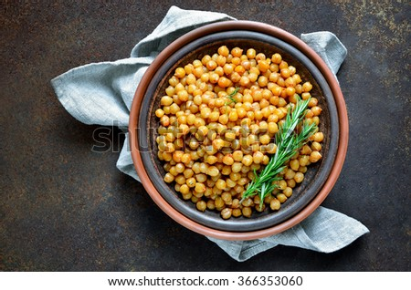 Roasted chickpea flavored with rosemary, view from above - stock photo