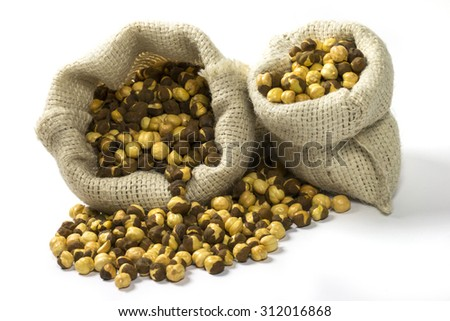 Roasted chickpeas (Chana) spilled out from jute sack  - stock photo