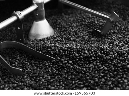 Roasted coffee bean in machine, background