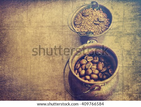 Roasted coffee beans and instant coffee in the old jugs on the old wood.Coffee vintage background with copy space. Retro instagram style image - stock photo