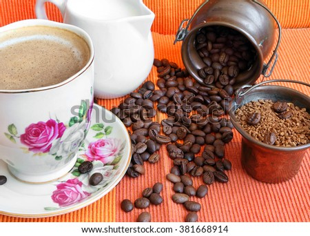 Roasted coffee beans and instant coffee in the old jugs with cup of cappuccino. Morning coffee still life in vintage set  - stock photo