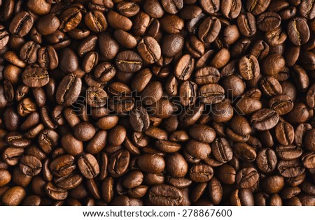 roasted coffee beans as a background, closeup, top view - stock photo