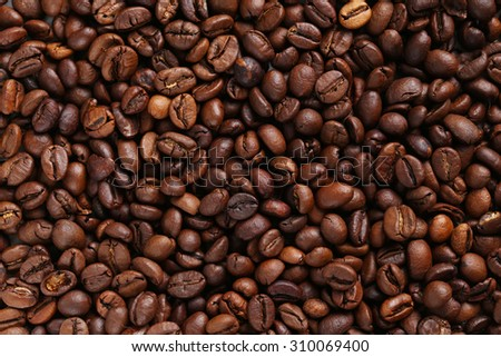 Roasted coffee beans background, close up - stock photo