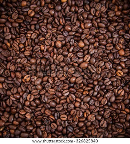 Roasted coffee beans background concept - stock photo