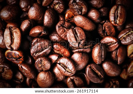 Roasted Coffee Beans background texture. Arabic roasting coffee - ingredient of hot beverage. Brown coffee beans for background and texture - stock photo