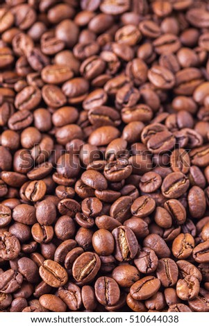 Roasted Coffee Beans background texture. Arabic roasting coffee - ingredient of hot beverage. Brown coffee beans for background and texture.