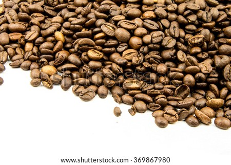 roasted coffee beans, can be used as a background / roasted coffee beans isolated in  background cutout - stock photo