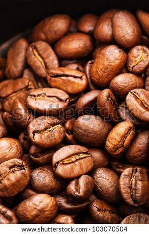 roasted coffee beans close-up as a background - stock photo