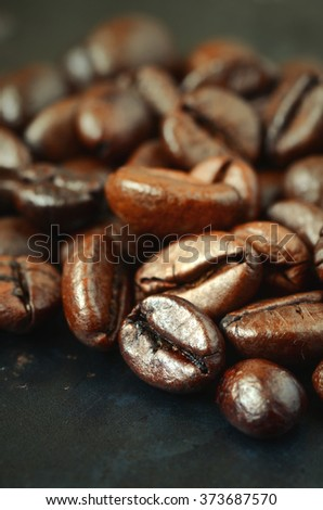 roasted coffee beans, close-up shot with macro lens - stock photo