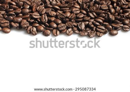Roasted coffee beans frame on white - stock photo